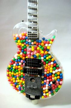Guitar shaped candy dispenser. Awesome!