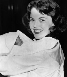 Shirley Temple, Mrs. Charles Black in private life, is shown leaving Santa Monica Hospital with her daughter, Lori, born Friday, April 17, 1954, Santa Monica, Calif. The Blacks also have a daughter Linda Susan, 6, and a son, Charles Jr., 2.