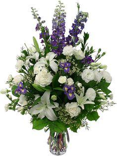 Blue hybrid delphinium, white lilies alstroemerias I'd add dahlias and iris