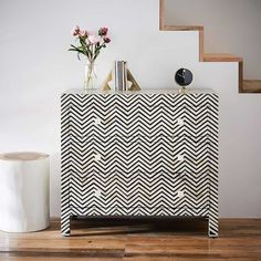 Storage doesn't have to be boring, just take a look at the Bone Inlaid 3-Drawer Dresser. Its hand-inlaid honeycomb pattern makes a style statement in any space.