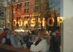 Silver foil lettering on storefront window. :)