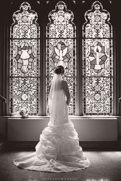 Bride's train in front of stained glass windows at church.  Wedding Photo