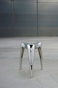Love this polished steel stool. Very War of the Worlds. ELEMENTS AT HOME