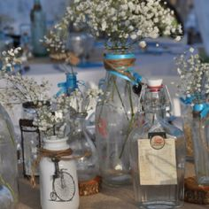 Decorated old bottles for table decor