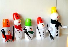 snowmans out of recycled joghurt cups or actimel bottles