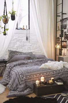I adore the macrame hanging plants and the curtains, the platform bed and the photo wall.
