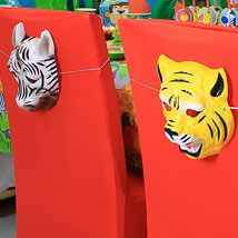 Complete Your Jungle Party Decorations With This Simple Idea To Decorate  Your Chairs   Cover Them