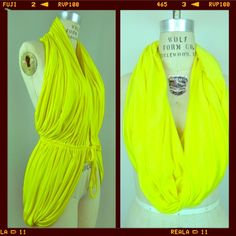 Multiway infinity scarf / vest yellow A multi purpose scarf made of super soft modal. Can we worn as a loop scarf, halter top, shrug etc... Your imagination is the only limit! genevieve Accessories Scarves & Wraps