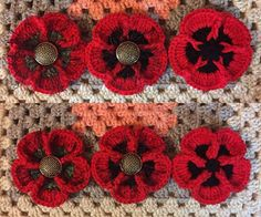 Remembering You Poppies - Free Crochet Pattern - These crochet Poppies can be worked in two ways. The top row of Poppies shows the central design area worked using a Single Front Post Treble. I later found that the buttons with shanks...
