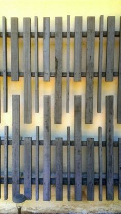 A blank facade is the perfect backdrop for this weathered wood wall sculpture on a vintage midcentury modern house in the Hollywood Hills