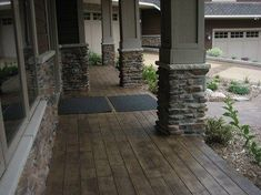 concrete porch floor stamped and stained to look like wide wood planks.