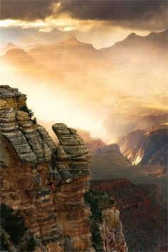 A mist of rain illuminated by the setting sun in the Grand Canyon