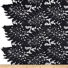 Palms Guipure Lace Black from @fabricdotcom  This mechanical lace fabric features a leafy pattern, smooth hand and is perfect for bathing suit cover-ups.