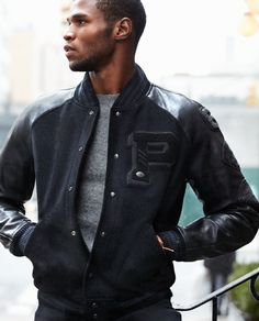 Downtown Cool: Inspired by vintage varsity styles, this wool jacket is designed with leather sleeves and embellished with football patches and pins.