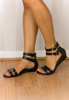 Black faux leather strappy flat sandal. (KARLIE)