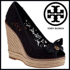 """Tory Burch Crochet Espadrille These wedges from Tory Burch are a timeless classic. The espadrille influence can be seen throughout while the crochet upper adds an extra summery appeal. Finishing off this sophisticated pair is a flattering peep-toe is topped with a charming bow and traditional logo charm. Crochet fabric upper. Fabric bow with gold-tone logo accent. Fabric lining. Rubber soles. Approx. 4 1/2 """" Rope covered wedge with 1"""" platform. Made in Spain. Tory Burch Shoes Wedges"""