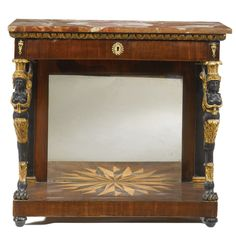 An Austrian Empire ormolu-mounted, parcel-gilt and ebonized mahogany console table, attributed to Carl Beck, Vienna, circa 1810.