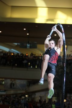 """April 25, 2012: """"Prepare for Launch."""" Glorious photo of Mark Hollis as he launches himself during Drake Relays Pole Vault in the Mall, an annual indoor pole vault competition held at Jordan Creek Town Center in West Des Moines, Iowa."""