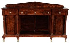Very Fine Norfolk, Virginia Federal Carved Mahogany Sideboard attributed to James Woodward, circa 1820, highly figured mahogany veneers, finely dovetailed drawers with poplar secondary, flanked by distinctive carved panels over two paneled lower drawers, each flanked by reeded columns with leaf-carved capitals, beehive turned legs with brass paw feet, one interior cabinet fitted with bottle turnstile, 51-1/2 x 85-1/2 x 25-1/2 in.