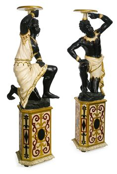 A pair of Venetian cream, parcel-gilt and polychrome decorated blackamoor torchères Italy, late 19th century.