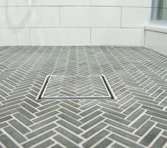 Hidden shower drain in a beautiful herringbone tile floor. Tile Shower Drain, Bathroom Drain, Shower Floor Tile, Small Bathroom, Master Bathroom, Bathroom Ideas, Hidden Shower, Hidden Toilet, Spanish Bathroom