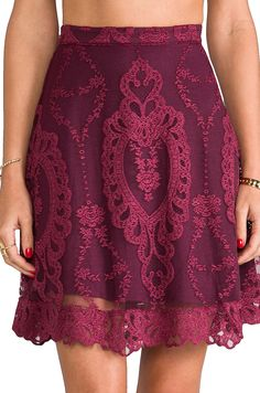For Love & Lemons Forever Skirt in Wine. A couple of things wrong with this skirt, the lining is cut poorly, you can see the lining on the model's right side is shorter than the left, and of course, the print is cut off grain and isn't centered. Who buys this sh!t?