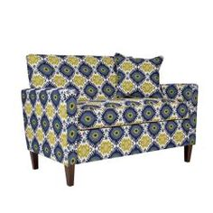 The angelo:HOME Sutton loveseat was designed by Angelo Surmelis. The Sutton loveseat has a slightly flared arm and is covered in a retro blue-green geometric fabric.