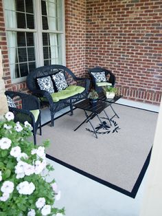 $18 outdoor rug from home depot and a quart of paint and you've got an awesome patio with whatever design you want.