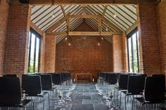 Set up for a civil ceremony at the stunningly contemporary Redhouse Barn wedding venue in Worcestershire   www.pwilletts.com