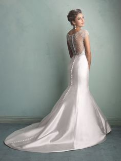 Who doesn't love a wedding dress with a dramatic back? From the new Allure Bridals collection.