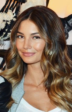 Lily Aldridge's Victoria's Secrets bombshell waves are painted with a lovely dirty blonde hue.   - MarieClaire.com