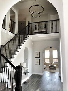 Pretty foyer - love the tiered chandelier. Paint color is Sherwin Williams Repos... - http://home-painting.info/pretty-foyer-love-the-tiered-chandelier-paint-color-is-sherwin-williams-repos/