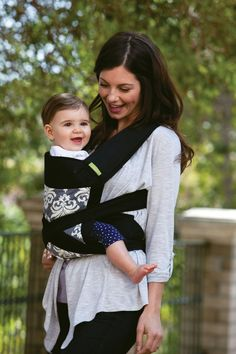 The Infantino Sash Mei Tai Carrier is a more structured version of the traditional baby wrap.