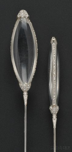 Pair of Platinum, Rock Crystal, and Diamond Hat Pins, Cartier | Sale Number 2610B, Lot Number 740 | Skinner Auctioneers