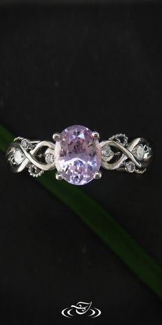 Organic swirl engagement ring.  Center Stone is a lavender center stone keeping the ring fresh and beautiful.