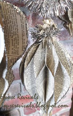 House Revivals honeycomb ornament made from vintage book pages, could be done with vintage sheet music or old maps, as well!