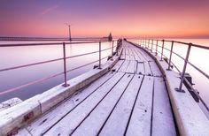 On A Cold and Frosty Morning.  A hard frost on the old wooden pier at Blyth Harbour, Northumberland. Taken on a very cold and beautiful Winter's morning.