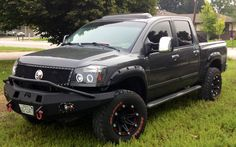 "2005 Nissan Titan, fab fours number, halos, bushwacker fender Flares, 35x12.5 general grabbers, tire gate, 3"" body lift."