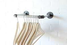 Industrial clothing rack with 10 front facing bar. This piece is 10 deep so hangers are meant to rest without touching the wall. Perfect for spaces where you would like to display clothing. All mounting hardware is included! This piece is cleaned and clear coated prior to shipping. This item ships via USPS priority mail and can be shipped internationally. If you like the idea but had something different in mind, please send me a custom order request