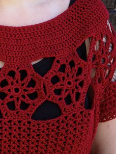 This crocheted tunic starts with a motif band worked for the shoulders. Then the neckline is worked by crocheting along the top of the motifs, and the sleeves and body are worked by crocheting along the bottom of the band.