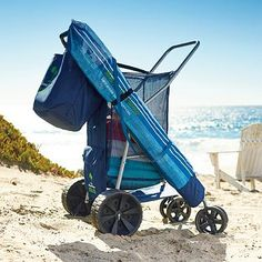 "Tommy Bahama Beach Cart  - $129.50  Frontgate   Rolls easily on wet or dry sand •  holds four beach chairs  • Roomy, heavy-duty mesh fabric compartment  • Small rear storage pocket for small belongings  • Removable, water-resistant, lined tote has 2 exterior pockets  Includes insulated, soft-sided cooler tote • Features side holders for an umbrella  Folds flat to store; folds to 27-1/2""W x 35""D x 12""H  • Extra-wide-tread rear wheels  pivoting front wheels  • Simple assembly"