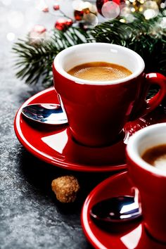 Coffee Espresso. Red Cups Of Coffee and Christmas decorations on dark background