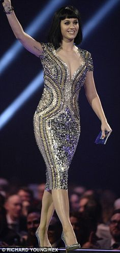 She wears it well: Katy Perry sported two different fetching outfits for her appearance at The Brit Awards on Wednesday