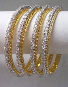 Look gracious with this white American diamond studded beangles. This is a set of four bangles. The design of this bangle will surely enhance your beauty when teamed with a matching outfit. data-pin-do= Diamond Necklace Set, Diamond Bangle, Diamond Studs, Diamond Jewelry, Silk Bangles, Bridal Bangles, American Diamond Jewellery, Gems Jewelry, Bangle Bracelets