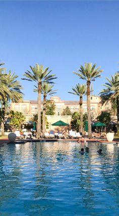 Gorgeous pool and palm trees | A romantic weekend getaway in Orlando at the Loews Portofino Bay Hotel at Universal Orlando | Beautiful water at sunset | Best hotels in Orlando | Universal Orlando vacation tips | Romantic travel tips | Orlando, Florida travel guide | Florida travel blogger Ashley Brooke Nicholas | #LoewsPortofinoBay