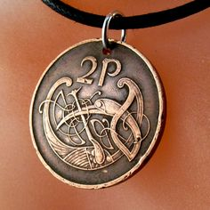 IRISH COIN Necklace Ireland coin celtic bird knot Pendant eire. 2p pence love knot . mens jewelry.  CHOOSE year No.001056 by PartsForYou on Etsy https://www.etsy.com/listing/98778912/irish-coin-necklace-ireland-coin-celtic