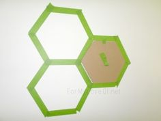 how to use a cardboard hexagon stencil for an accent wall, For My Love Of featured on Remodelaholic