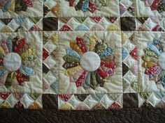 I adore the colours and design of this quilt made by Vicki  as a birthday present for her mother in law.    Although I quilted it several we...