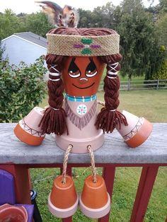 One of my favorites, terra cotta pot Indian girl by Pekes Artistry