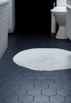 Love the dark grey floor and the white subway tile